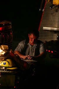 Accountability  Firefighter for Clear Spring Fire and Rescue keeps track of firefighters on a fire scene
