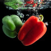 Peppers dropping into water. The color of peppers makes them awesome photographic subjects.