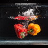 One of the unedited shots of peppers dropping into water.