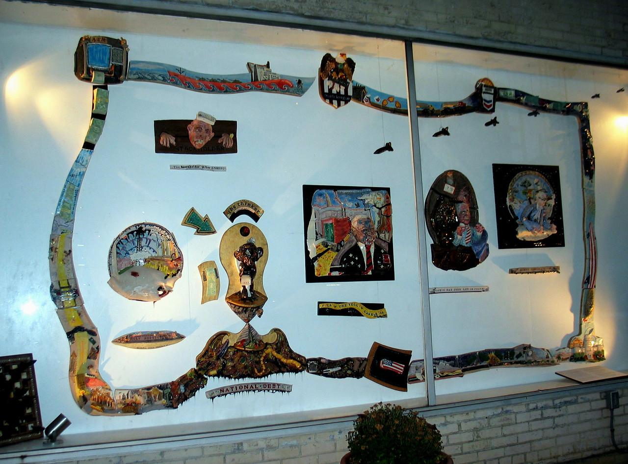 """Bush League: 2004"" Porcelain  & m.m. wall mural, 7' x 13' x 9"" installed 10/04 at 3107 Clarendon Blvd., Arlington VA  Collection of  David Shurtz, esq."