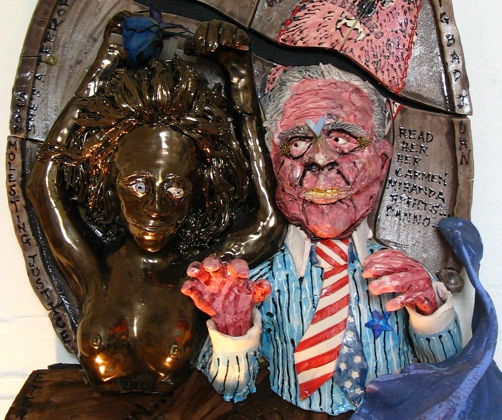 """""""Bush League: 2004"""" Detail; """"Big Bad John (with Lady Justice): Eternal salivation"""" Glazed porcelain, m.m., 28"""" x 16"""" x 7"""""""