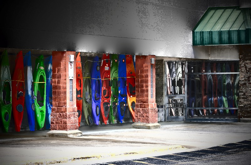 Colorful Kayaks reflecting in the windows