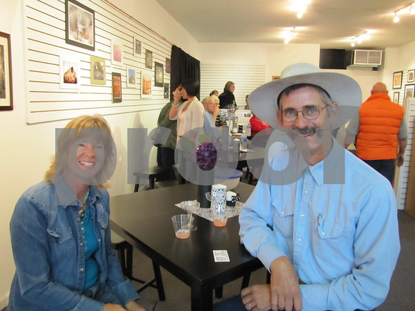 Jane and Craig Fiscus enjoy refreshments while attending the opening for local photographers at PCGA on Central Ave., Fort Dodge.
