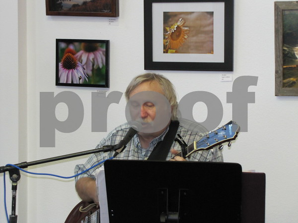 Denny Simmon played music throughout the evening at PCGA's opening for local photographers.