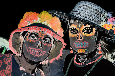 A partial reversal of light and shadow makes this All Souls Procession image even more phantasmal.
