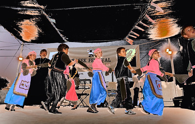 A reversal of light and shadow renders these Greek children dancers more colorful