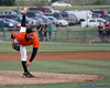6/20/11: Taken at a recent Frederick Keys game.  Should have used a faster shutter speed, so the hand and foot would be sharper, but loved how the left foot is straight up.  Fun taking pictures at 8 frames a second!