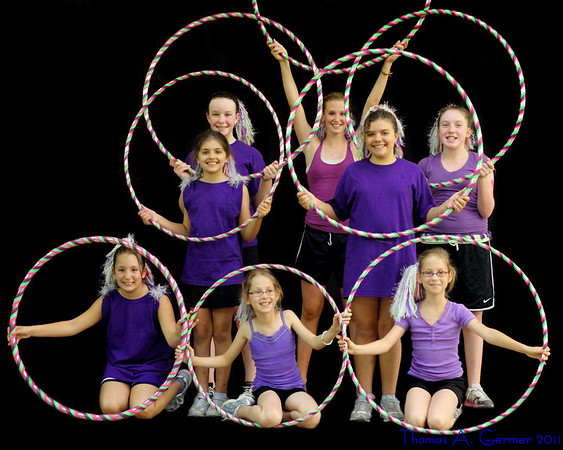 7/7/2011: If I had known that the Shooting Stars Hoop Troupe was giving their demonstration indoors, I would have brought lighting and a better back- and floor-drop.  As it was, I found a black curtain wall, and photoshopped out the floor.