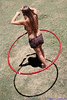 """7/21/2001: Hula hooper at the Linganore Winery Reggae Festival.  I liked the location of the hoop in the photo and the shadow cast on the ground.  Problem was there were other people in the background that distracted from the composition. After a little PS, I got a much better image.  See <a href=""""http://www.tagermer.com/Friends/Linganore-July-2011/18085875_G9ggZq#1388437692_9LWLq3P"""">original image</a> for comparison.  See the entire series at <a href=""""http://www.tagermer.com/Friends/Linganore-July-2011/18085875_G9ggZq"""">Linganore July 2011</a>."""
