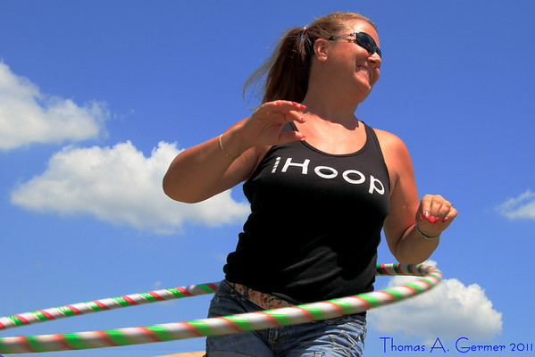 """7/20/2011: Angel Rutsch, owner of <a href=""""http://www.rock-a-hoola.com"""">Rock-a-Hoola Hoops</a>, at the Linganore Reggae Wine Festival in Mt. Airy, MD.   More from this series in the album <a href=""""http://www.tagermer.com/Friends/Linganore-July-2011/18085875_G9ggZq"""">Linganore July 2011</a>."""