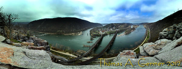 Harper's Ferry, WV, from Maryland Heights<br /> <br /> This is a stitched HDR panorama with rectilinear mapping.  C&O Canal follows the Potomac River down below. The Potomac is flowing to the left and the Shenandoah River joins it in the middle of the photograph.  This is 6155x16244 pixels, multiple shots taken with a 17 mm (of a 17-85 mm zoom) lens.  If you were to zoom in, you can see the people walking in the town.<br /> <br /> Been away from the Dailies for awhile, but this is the Daily Photo for 3/21/2012.