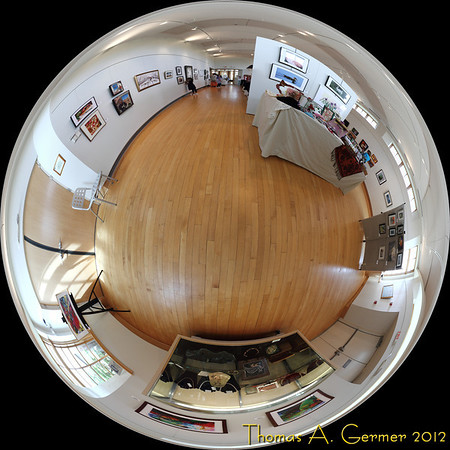 Shades of Spring 2012, Art League of Germantown spring show at BlackRock Arts Center, Germantown, MD.<br /> <br /> This photograph is an equisolid projection view of the room, which is the limit of what you would see if viewing a metal sphere from infinity. Stitched from 13 different shots. Over the next several days, I am posting on my daily photos gallery different projections from this single set of pictures, illustrating the wide range of perspectives that one can have from a single vantage point.<br /> <br /> Daily Photo: 4/3/2012