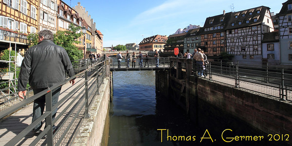 Lock in Strasbourg, France.<br /> <br /> Funny that my camera seems to know when I take the picture horizontally, and if vertically, whether I took it rotated one way or the other. However, when I take the picture upside down, it doesn't sense that.  This picture had to be flipped around. I took it by holding the camera out over the water with my right hand. The only way to do this was to hold the camera upside down.<br /> <br /> Daily photo: 5/23/2012