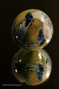 Glass sculpture - our big splurge at a gallery in Beaver Creek, CO a few years ago.  I thought it looked like the earth and had to have it.  ;-)
