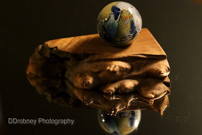 The little glass 'earth' in its stand...on an antique mirror.
