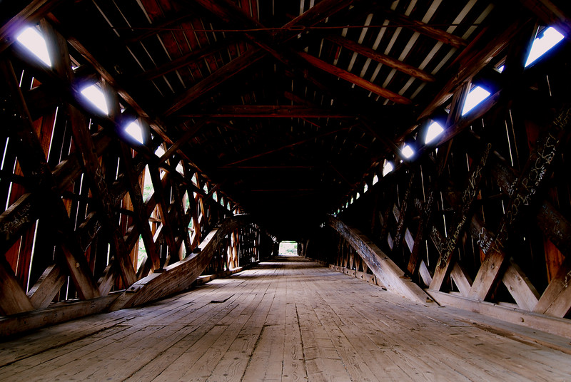 Old Fashioned Engineering<br /> <br /> A wooden bridge in Vermont...  I'm not driving across it.  Walking was scary enough!