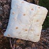 Underside.  Opening allows access to remove stuffing for replacement or hand-washing the pillow.
