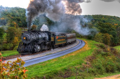 Western Maryland 734 with some help on the rear, pulls the Saturday excursion around Helmstetters Curve