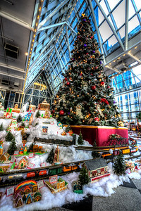 The Christmas Tree and train display inside PPG Place