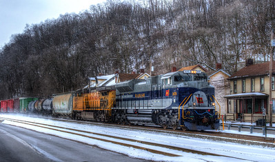 Amid snow flurries, NS16 with the Wabash heritage units kicks up the snow as it heads east on the Conemaugh Line at MP54
