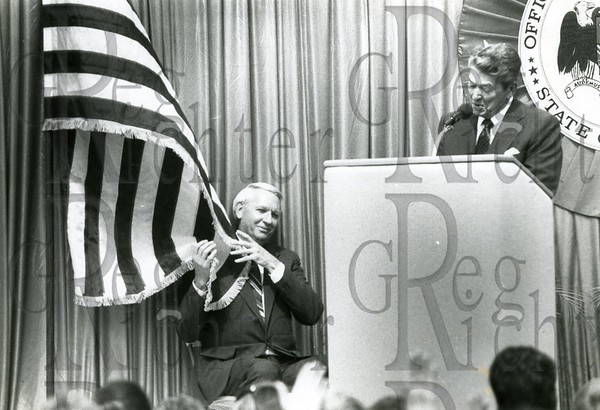 Alabama Gov. Guy Hunt gets wrapped in the flag as former President Ronald Reagan campaigns for him in Hoover, Alabama in 1990.