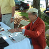 "The great John Fitch at the Greenwich Concour Singing his book 2005, ""Racing With Mercedes""."