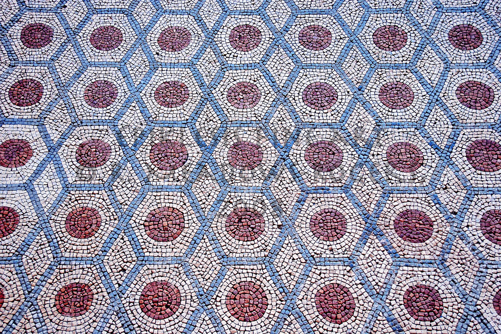 <center>Hexagonal Embraces Roman Mosaic Floor: Conimbriga, Portugal © R. Meadows-Rogers, 2008</center>