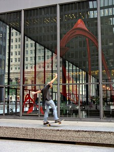 As I was trying to capture the reflection of the Flamingo sculpture in the windows along with the scale model inside the building, this skateboarder showed up.  I took a couple action shots, and I think they followed me to the Picasso sculpture nearby at Daley Plaza!