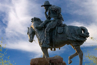 Bronze sculpture of cowboy at the Shops of Legacy