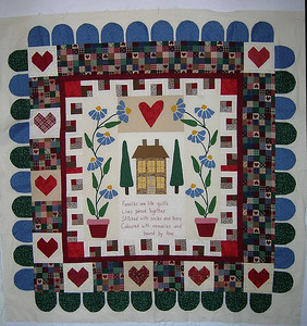 Linda's quilt, with borders by DD, Ann (with paper-pieced hearts), and Joan's great free-form scallops, which are not sewn down to the background. Linda can sew them down, or perhaps sew a button to each scallop for a unique effect.