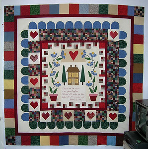 "This very traditional, ""country"" quilt is as far away from my color palate and quilting style as it's possible to get! Fortunately, I had a box full of six-inch squares from places unknown, that I'd been saving for reasons unknown, as I never expected to use them. Surprise! They were just right for my contribution to Linda's quilt!"