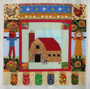 """Ann's """"County Fair"""" centerpiece with the first border created by Joan."""