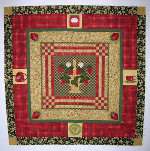 Sallie's appliqued strawberry basket center block, with borders by Linda, DD, Ann and Joan.