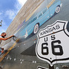 Globe/T. Rob Brown<br /> Branden Yost of Joplin, an RC Tile & Hardwoods installer, adds another tile to a Route 66 mural in downtown Galena, Kan., Tuesday afternoon, June 26, 2013. The mural, designed by art director Chris Auckerman and graphic designer Jon White, both with Images in Tile owned by Paul Whitehill, is located at the intersection of 7th and Main streets in Galena.