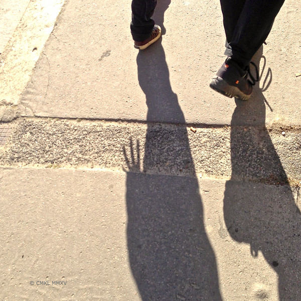Late afternoon - a mother and her son walking home