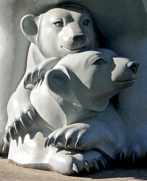 Polar bear cubs in marble