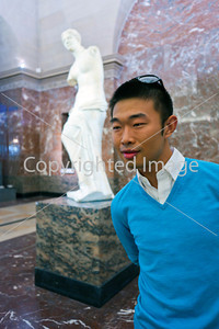 Paris, France, Young Chinese Man Visiting in Louvre Museum, Posing beside Venus di Milo Statue