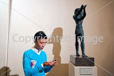 Paris, France, Portrait Chinese Man, Visiting in Louvre Museum, Egyptian Antiquities, Looking at I-phone Application