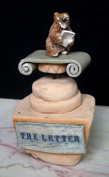 "John Aaron  Sculpture in Clay ""The Letter"" (2006) introducing phred the marmot Glazed porcelain, mixed media 7"" x 12"" x 12""  Collection of the Artist"