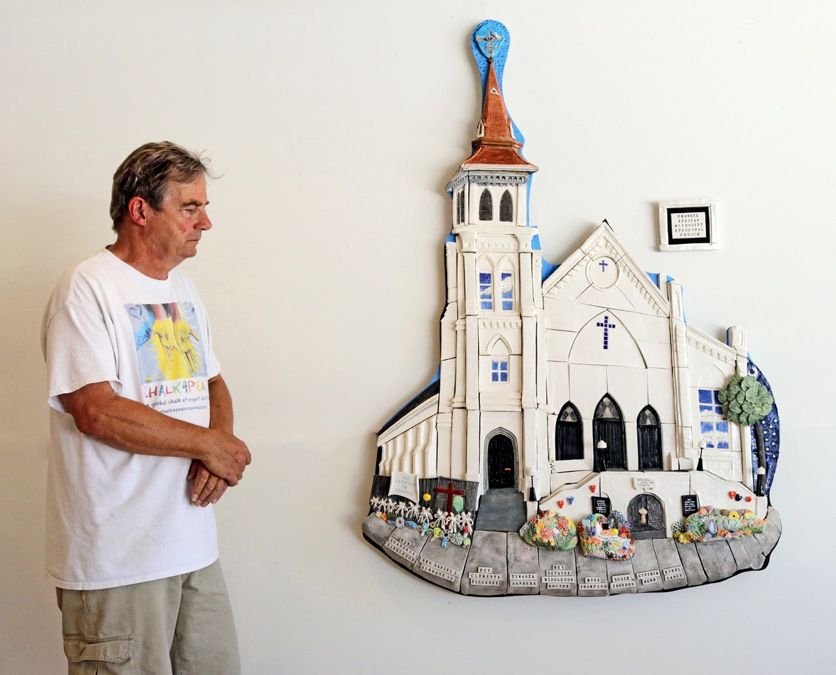 Artist with sculpture of Emanuel AME Church