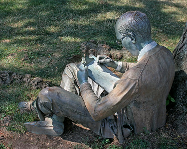 Sculpture of man studying at Hofstra University