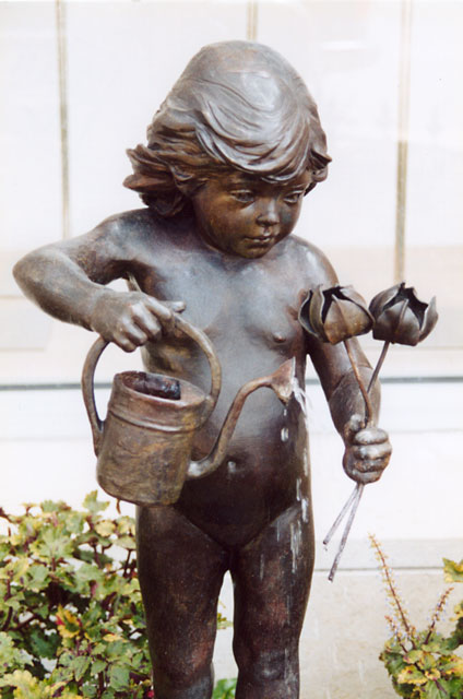 Child with watering can.