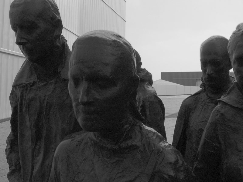 These bronze sculptures were made from the life casts of living models.<br /> I felt it looked better in black and white because of the brightness of the background.<br /> Only slightly altered in Elements 2.<br /> I am sorry I forgot to get the name of the artist.