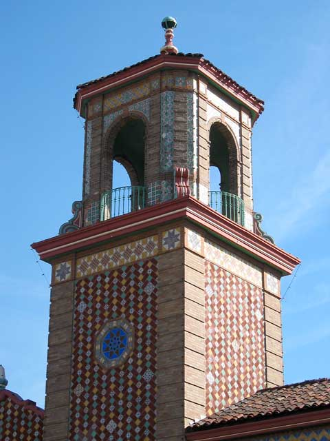 Tower with colorful tiles on the Plaza.