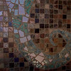 hand made art tiles inlaid into mosaic tile
