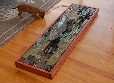 Run Salmon Run, a life-sized salmon sculpture swimming upriver on a bed of ceramic tile.