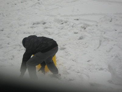 My younger son is helping me with collecting the snow!