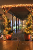 The lights' and decorations of Brenda's Blumenladen give off a warm glow in the December fog.