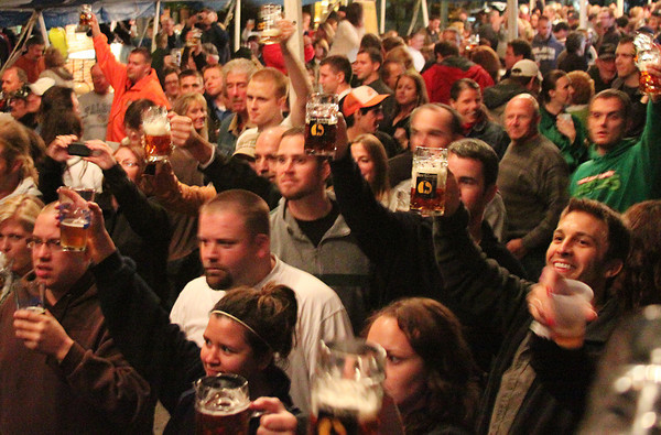 The crowd raises their glasses in a toast at Oktoberfest, held in New Glarus and sponsored by the New Glarus Brewing Company.