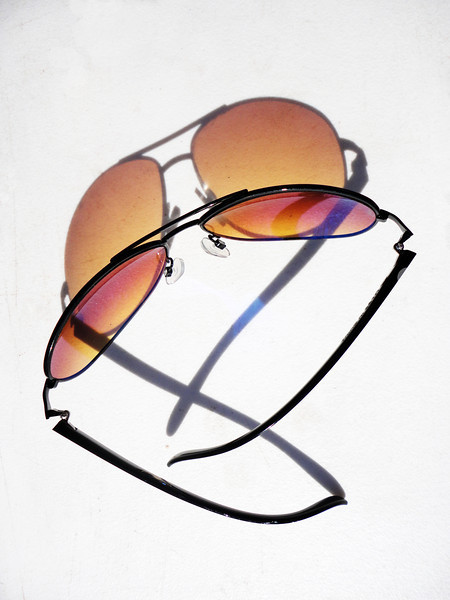 A pair of sunglasses reflects both light and shadow at the Swap Shop Flea Market in Fort Lauderdale, Florida.